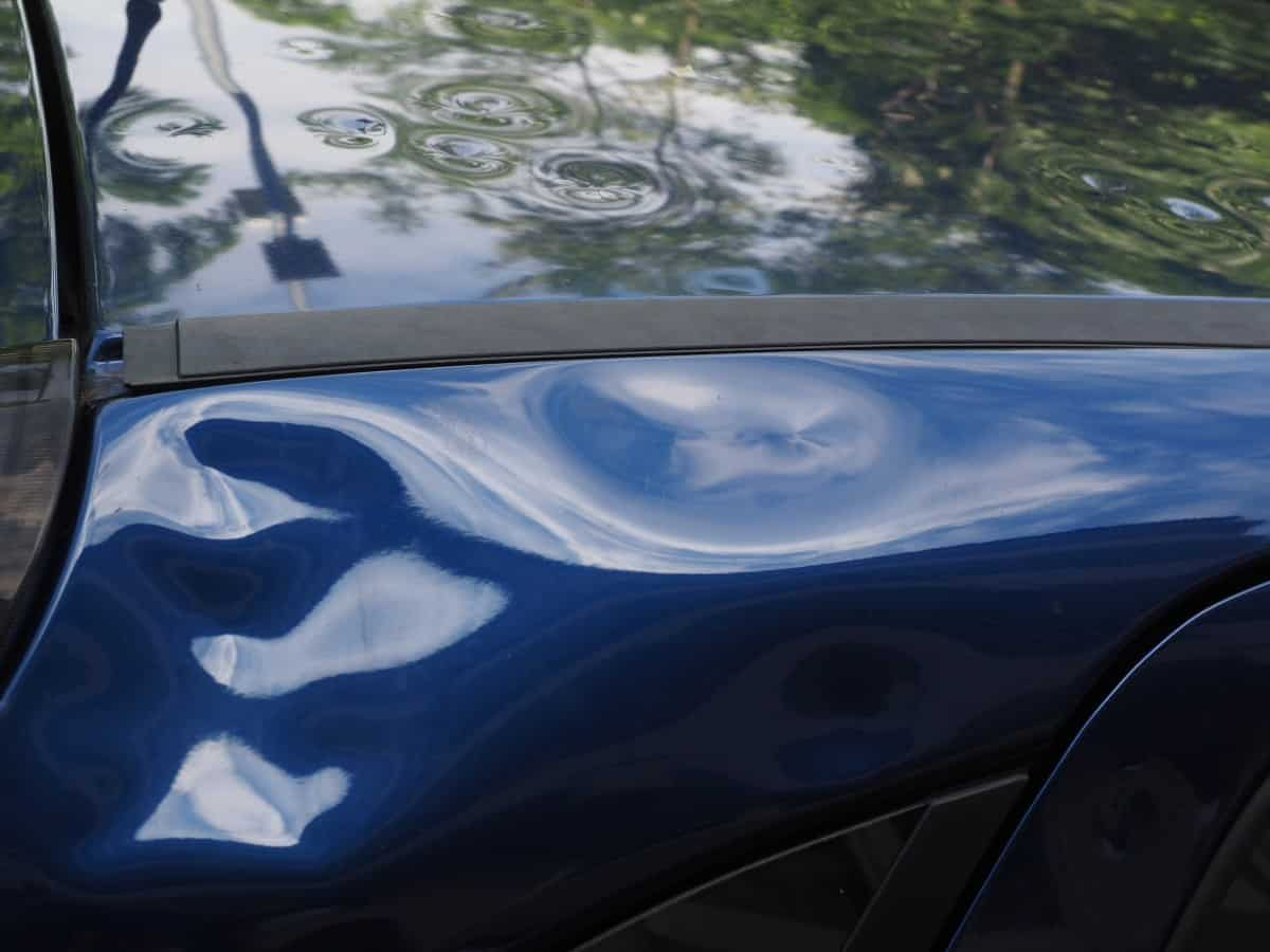 how to fix a large dent in a car door